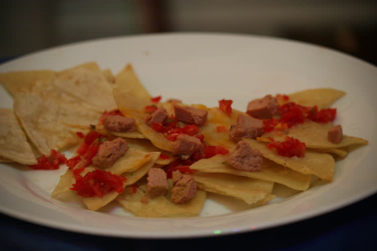 Corn tortillas with duck pate, cherry tomatoes