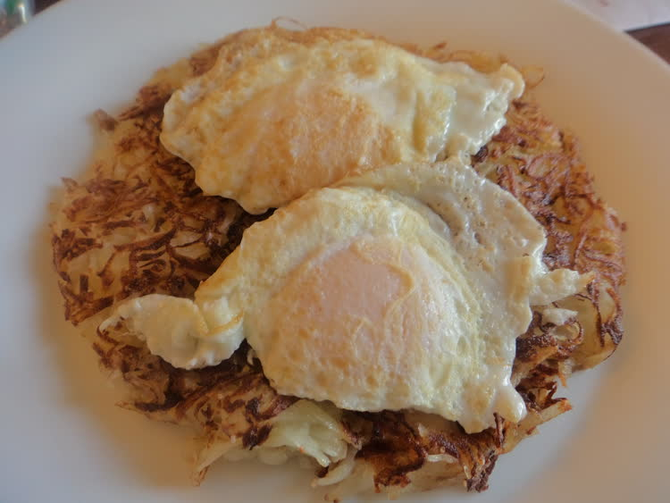 Rosti with fried egg for breakfast.