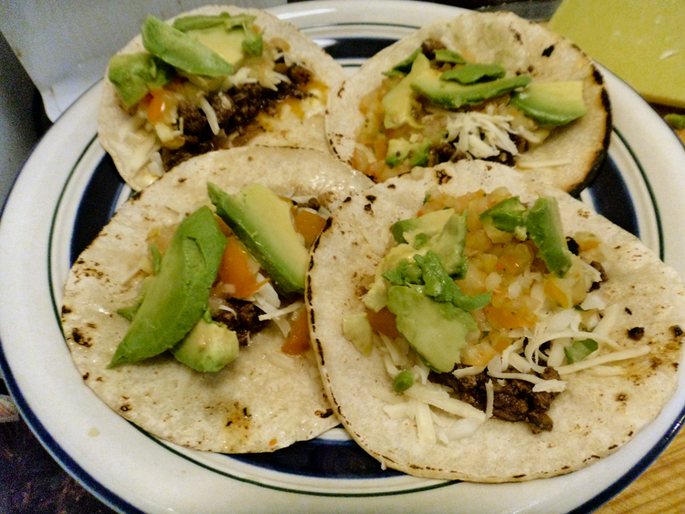 Beef taco with yellow salsa and avocado